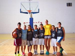 Christiana (second from right) with WNBA player, Kelly Schumacher, and her Lead 4 Peace teammates at the 2013 PeacePlayers Summer Camp