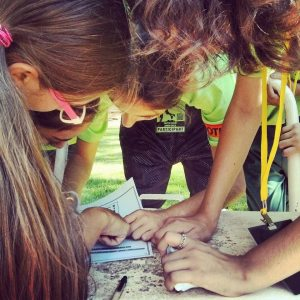 PPI-CY participants working together during a scavenger hunt at summer camp