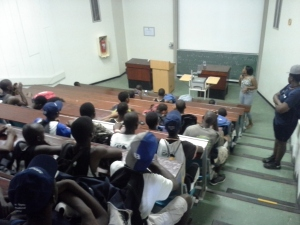 Teens experience the real thing, as tour guide and former PPI Coach Sbahle gives them a quick lecture