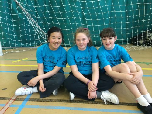 Catholic and Protestant students from Holy Cross Primary School and Wheatfield Primary School play sports together.