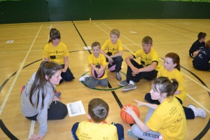 PPI-NI coach Niamh Burns who is also a Senior Champion4Peace working on a winning plan with her team.