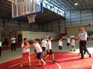 Brad (far right) plays basketball with PeacePlayers kids in the Mesashe region.