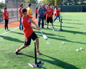 Mussa takes a swing at the plate while volunteering with the Washington Nationals Youth Baseball Academy