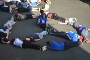 Participants having fun while creating  signs with their bodies.