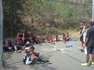 Coach Yamkela, leading the boys LDP team through a life skills activity