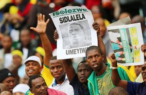 Fans honouring fallen star Senzo Meyiwa during the match Saturday. Photo Credit: www.newvision.co.ug