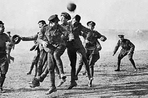 British and German soldiers play football together in No Man's Land during the Christmas Truce
