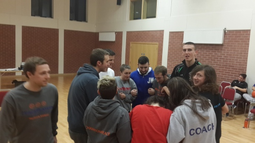 Coaches during an activity demonstrating a way of being