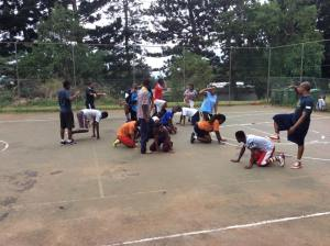 PPI-SA coaches participate in a role playing game.