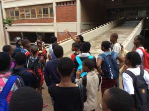 PPI-SA coach, and UKZN Howard Student, Thando  Msweli, shows students around the campus