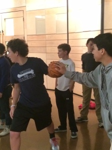 7th graders participate in basketball drills that emphasize teamwork