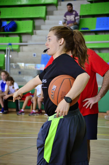 Courtney refs a game that PPI - ME played with the U.S. Ambassador this past December. Photo: Joel Dzodin.