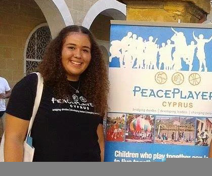 Helen, representing PeacePlayers at a fair in Nicosia