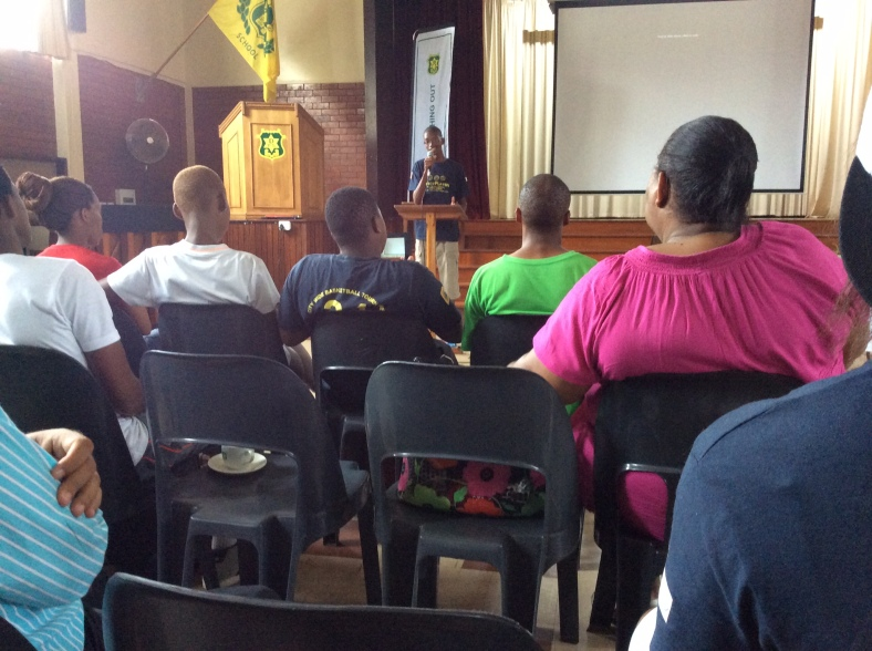 Tramayne speaking in front of PPI-SA's school reps earlier this year