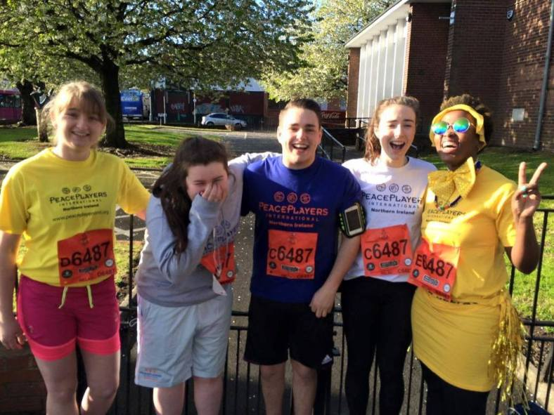 Laura Agnew, Niamh Burns, James Proctor, Hannah Byrne and Nasiphi Khafu in their PeacePlayers gear ready for the race
