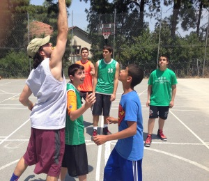 International Fellow, Ryan Hage, tossing up a jump ball