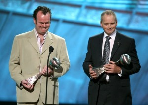 Trevor Ringland and Dave Cullen receiving the 2007 Arthur Ashe Courage Award for their work with PPI.