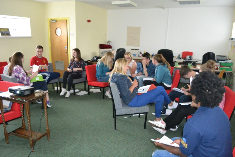 Participants working together to discuss their experiences of culture diversity in NI