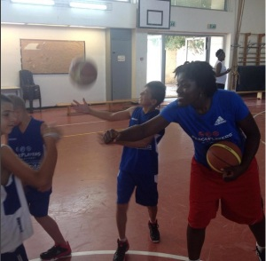 Coach Ro leading a basketball drill in Jerusalem