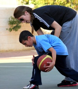 Jamie coaches a young PeacePlayer in Jerusalem
