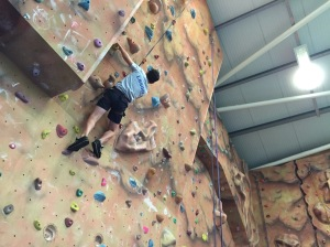Senior boys supported each other to reach the top of the climbing wall