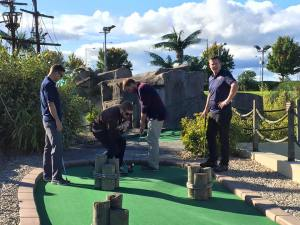 Leif mini golfing with PPI-NI staff
