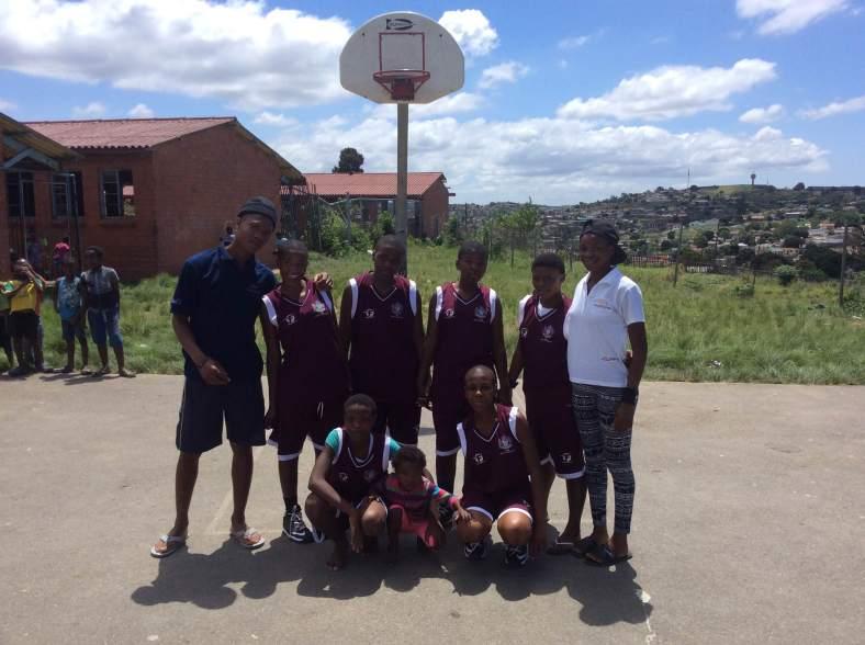 Coaches Thandeka Thusi and Khulekani Ngcobo with their girls LDP team