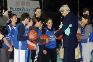 Kerry at the Ledra Palaca Hotel Court signing basketballs and speaking with leaders.