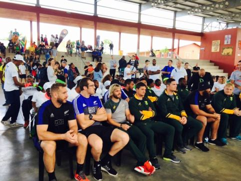 South African Springboks and New Zealand All Blacks sitting together at the #WeLIV4Peace Event.